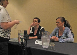 Jill Marr (seated left) and Cari Foulk listening to a question at Killer Nashville 2010.