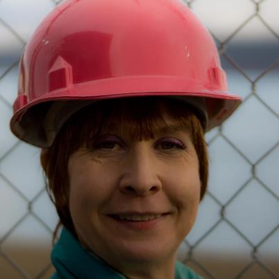 A hairdresser and her hard hat