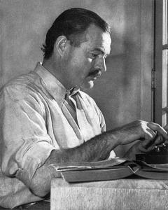 Ernest Hemingway at typewriter