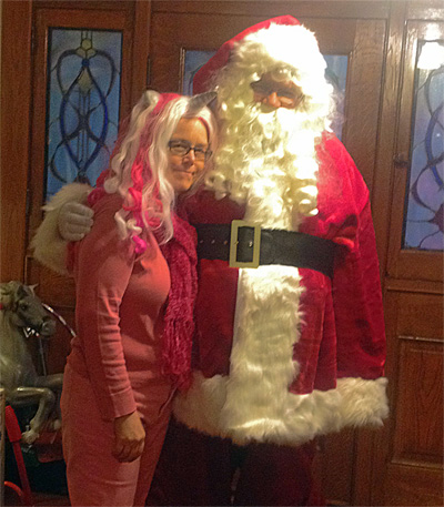 Santa Claus and the Pink Unicorn Lady. Nothing says Halloween quite like a woman in pink with a horn on her head.