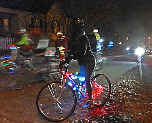 Riding a bike at night, with over a thousand friends.