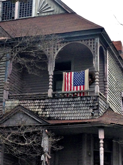 An old house; a new flag. The problems and the promises run deep.